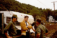 John Murtha observing damage from the Johnstown Flood of 1977.