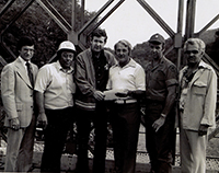 John Murtha  and others at the Bailey Bridge in New Florence, PA after the Johnstown Flood. 1977.
