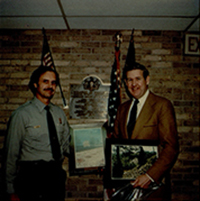 National Park Service presenting John Murtha with photos of Lemon House and South Fork Dam, c. 1970s.