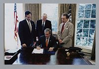 John Murtha, President George W. Bush, Senator Rick Santorum, and Senator Arlen Specter signing legislation, 2006.